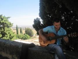Paco playing the guitar at Medina Azahara