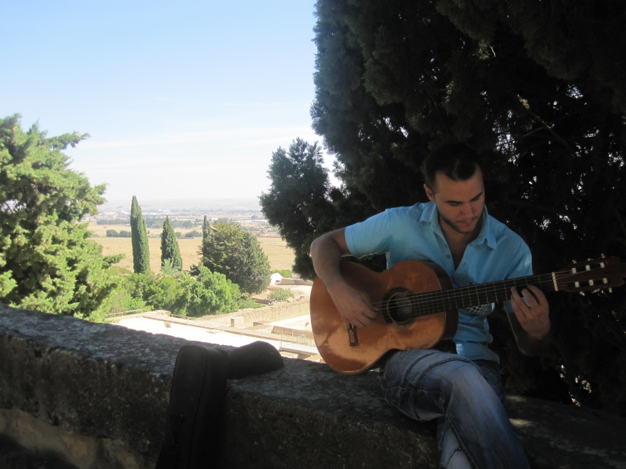 Paco playing the guitar at Medina Azahara
