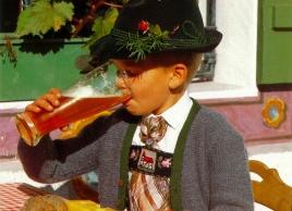 Boy drinking beer in Munich
