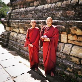 Monks_leaving_offerings_at_the_sacred_Temple_of_the_Tooth_in_Kandy__Sri_Lanka