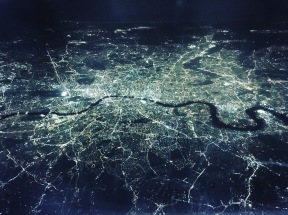 Aerial view of London lights at night from a plane