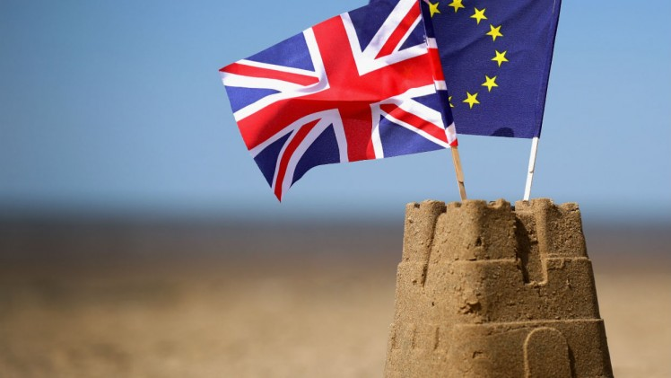 Europe in crisis - Brexit & EU flags in sandcastle