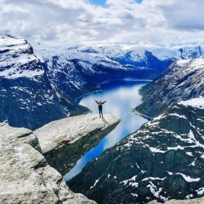 At_long_last_after_5_hours_of_hiking_through_the_snow__we_reached_Trolltunga__Literally_translated_as__troll_s_tongue___this_famous_rock_in_Norway_juts_out_a_dizzying_700m_above_the_wate
